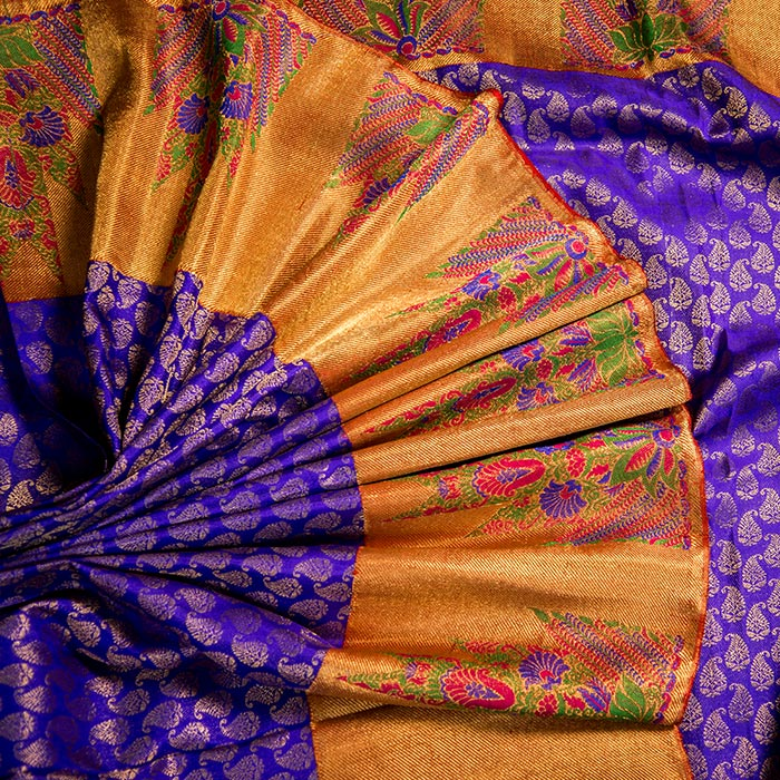 Royal blue Kanchipuram silk saree with exquisite thread weaving