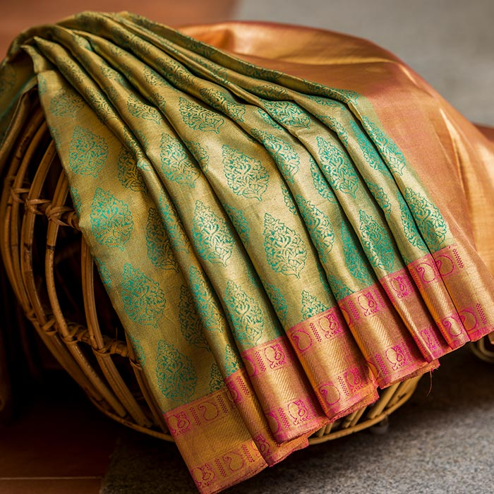 Golden Kanchipuram silk saree with peach border